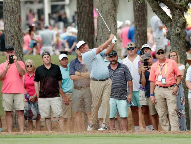 Jason Dufner hits off the 15 hole fairway, during the final round of The Players Championship golf tournament Sunday, May 13, 2018, in Ponte Vedra Beach, Fla. (AP Photo/John Raoux)
