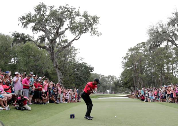 Tiger Woods hits from the 15 tee, during the final round of The Players Championship golf tournament Sunday, May 13, 2018, in Ponte Vedra Beach, Fla. (AP Photo/Lynne Sladky)