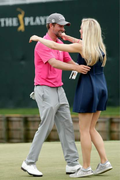 Webb Simpson is greeted by his wife Taylor Dowd Simpson after winning The Players Championship golf tournament Sunday, May 13, 2018, in Ponte Vedra Beach, Fla. (AP Photo/John Raouox)