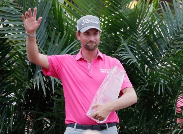 Webb Simpson waves after receiving The Players Championship trophy, Sunday, May 13, 2018, in Ponte Vedra Beach, Fla. (AP Photo/Lynne Sladky)