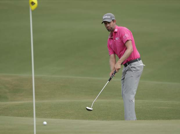 Webb Simpson watches his putt on the eighth green, during the final round of the The Players Championship golf tournament Sunday, May 13, 2018, in Ponte Vedra Beach, Fla. (AP Photo/John Raoux)