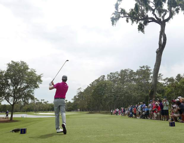 Webb Simpson hits from the sixth tee, during the final round of the The Players Championship golf tournament Sunday, May 13, 2018, in Ponte Vedra Beach, Fla. (AP Photo/John Raoux)