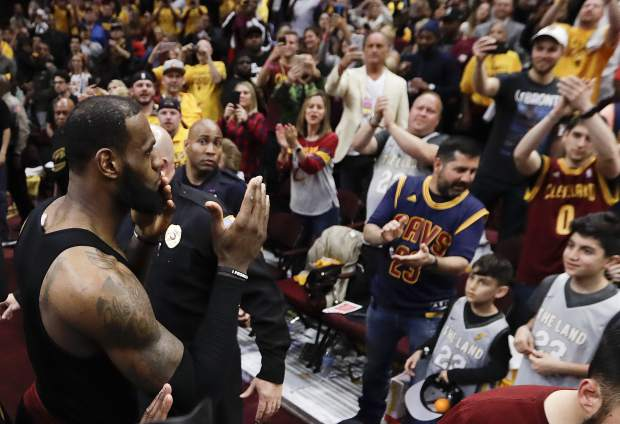 Cleveland Cavaliers' LeBron James blows kisses as he walks off the floor after a 128-93 victory over the Toronto Raptors in Game 4 of an NBA basketball second-round playoff series, Monday, May 7, 2018, in Cleveland. (AP Photo/Tony Dejak)