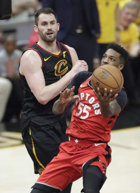 Toronto Raptors' Delon Wright (55) shoots past Cleveland Cavaliers' Kevin Love in the second half of Game 4 of an NBA basketball second-round playoff series, Monday, May 7, 2018, in Cleveland. (AP Photo/Tony Dejak)