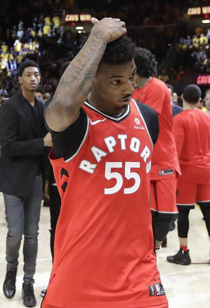 Toronto Raptors' Delon Wright walks off the court after a 128-93 loss to the Cleveland Cavaliers in Game 4 of an NBA basketball second-round playoff series, Monday, May 7, 2018, in Cleveland. (AP Photo/Tony Dejak)