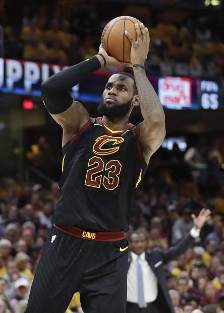 Cleveland Cavaliers' LeBron James shoots against the Toronto Raptors in the first half of Game 4 of an NBA basketball second-round playoff series, Monday, May 7, 2018, in Cleveland. (AP Photo/Tony Dejak)