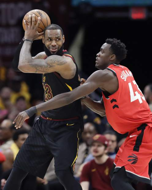 Cleveland Cavaliers' LeBron James looks to drive on Toronto Raptors' Pascal Siakam (43), from Cameroon, in the second half of Game 4 of an NBA basketball second-round playoff series, Monday, May 7, 2018, in Cleveland. (AP Photo/Tony Dejak)