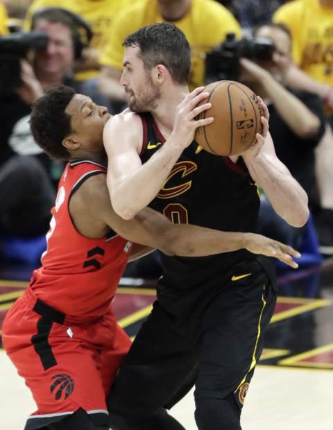 Toronto Raptors' Kyle Lowry defends Cleveland Cavaliers' Kevin Love in the second half of Game 4 of an NBA basketball second-round playoff series, Monday, May 7, 2018, in Cleveland. (AP Photo/Tony Dejak)