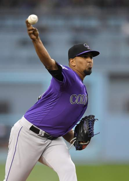 Colorado Rockies starting pitcher German Marquez throws to the plate during the first inning of a baseball game against the Los Angeles Dodgers Monday, May 21, 2018, in Los Angeles. (AP Photo/Mark J. Terrill)