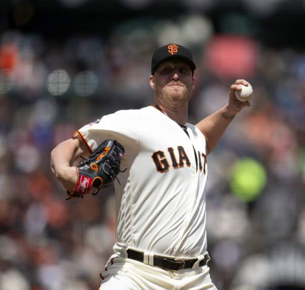 San Francisco Giants pitcher Will Smith delivers against the Colorado Rockies during the sixth inning of a baseball game, Sunday, May 20, 2018, in San Francisco. (AP Photo/D. Ross Cameron)