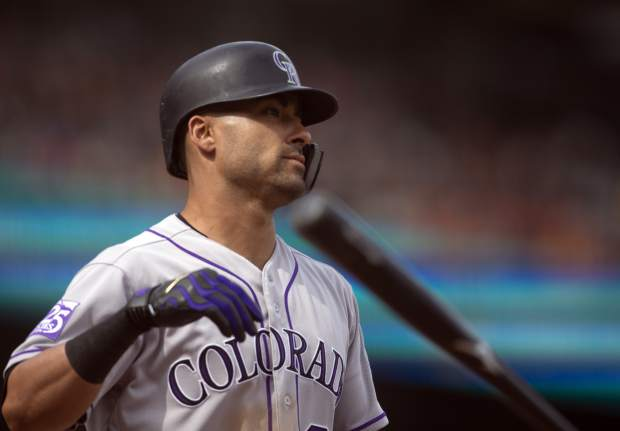 Colorado Rockies' Ian Desmond throws his bat after striking out during the eighth inning of a baseball game against the San Francisco Giants, Sunday, May 20, 2018, in San Francisco. (AP Photo/D. Ross Cameron)