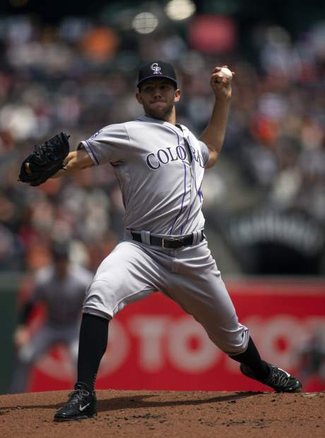 Colorado Rockies starting pitcher Tyler Anderson delivers against the San Francisco Giants during the first inning of a baseball game Sunday, May 20, 2018, in San Francisco. (AP Photo/D. Ross Cameron)