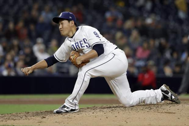 San Diego Padres relief pitcher Kazuhisa Makita, of Japan, works against a Colorado Rockies batter during the sixth inning of a baseball game Monday, May 14, 2018, in San Diego. (AP Photo/Gregory Bull)