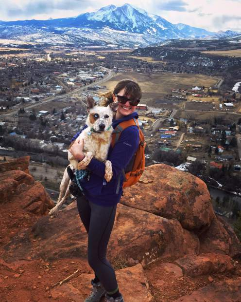 Chelsea Self and her dog Kiva on Mushroom Rock.