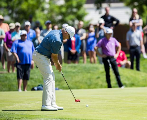 John Elway putts his ball on the third green as he competes in the U.S. Senior Open Qualifier at the Broadmoor East Golf Course, Monday, May 28, 2018, in Colorado Springs, Colo. (Dougal Brownlie/The Gazette via AP)