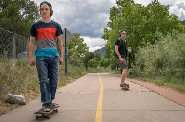 Isaac Williams and Brandon Hunter ride their skateboards down the Rio Grande bike path in Glenwood Springs on a warm but cloudy Tuesday afternoon.
