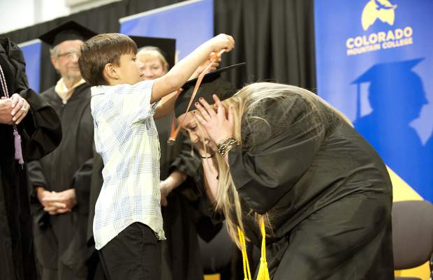 Tiffany Brickell is pinned by her son Cody at the pinning ceremony and graduation for nursing students at Colorado Mountain College Spring Valley May 5. She received her Bachelor of Science in nursing.
