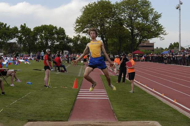 Roaring Fork senior Jasper Germain takes off in the 3A triple jump Thursday at JeffCo Stadium.