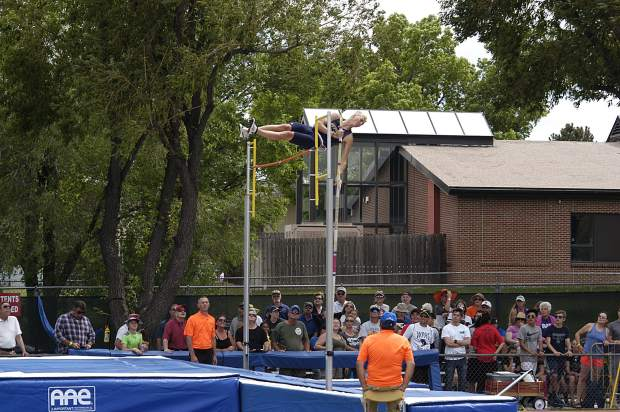 Rifle senior Riley Ellsworth clears the bar during the 3A pole vault competition at JeffCo Stadium.