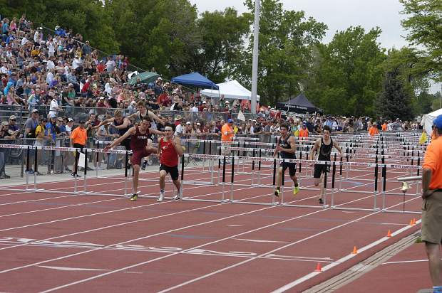 Rifle junior Joel Lopez closes in on the final hurdle during Thursday's 3A 110m hurdles preliminary race at JeffCo Stadium.