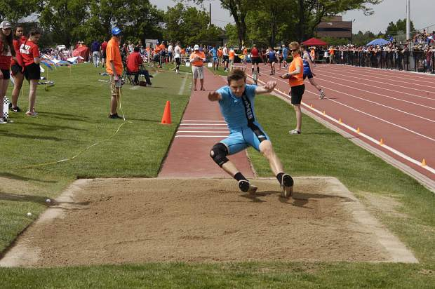 Coal Ridge senior Billet Porter lands into the sand during Thursday's 3A triple jump at JeffCo Stadium.