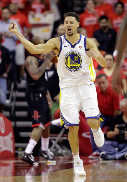Golden State Warriors guard Klay Thompson (11) celebrates after scoring against the Houston Rockets during the second half in Game 7 of the NBA basketball Western Conference finals, Monday, May 28, 2018, in Houston. (AP Photo/David J. Phillip)