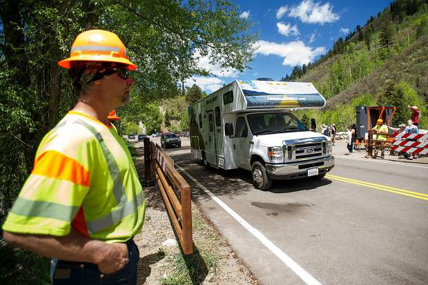 A camper drives through the opened gate from Colorado Department of Transportation workers on Independence Pass Road on Thursday at noon for car traffic for the summer season.