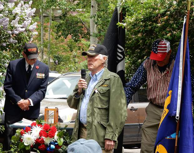 U.S. Army veteran Charlie Hopton (center) gives an emotional tribute to the late Pepper Gomez at Aspen's Memorial Day Observance on Monday as veterans Dick Merritt (left) and Dan Glidden bow their heads. Gomez passed away last May.