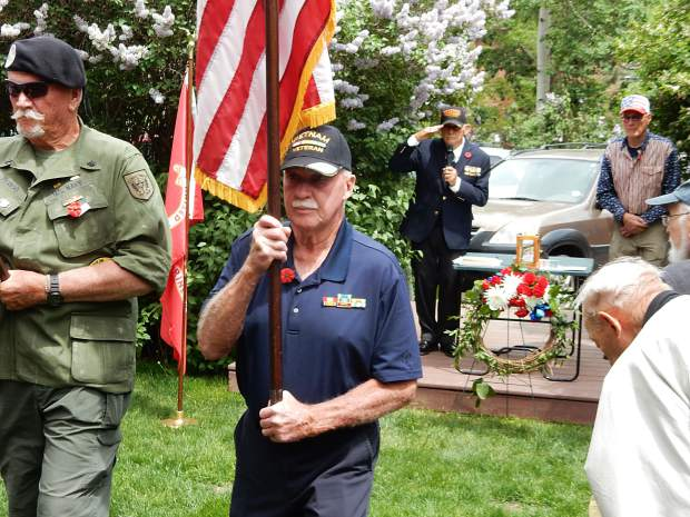 Bob Perigo and Palmer Hood undertake the Retirement of the Colors at Aspen's Memorial Day Observance on Monday.
