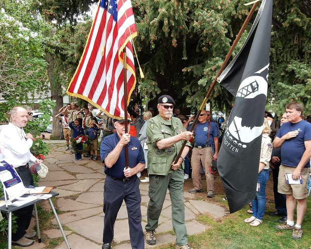 Palmer Hood, left, and Bob Perigo of the Roaring Fork Valley Veterans Honor Guard undertake the Presentation of the Colors at Aspen's Memorial Day Observance on Monday. Both men were U.S. Navy veterans.