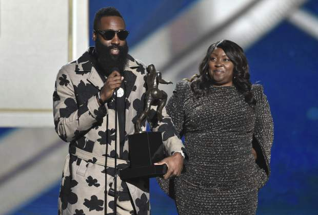 CORRECTS SPELLING OF LAST NAME TO HARDEN, INSTEAD OF HARDIN - NBA player James Harden, of the Houston Rockets, left, accepts the most valuable player award as his mother, Monja Willis, looks on at the NBA Awards on Monday, June 25, 2018, at the Barker Hangar in Santa Monica, Calif. (Photo by Chris Pizzello/Invision/AP)