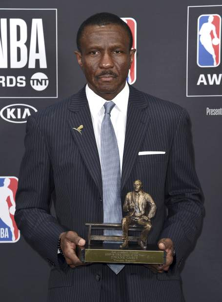 Dwane Casey, current head coach of the Detroit Pistons, poses in the press room with the coach of the year award for his work with the Toronto Raptors at the NBA Awards on Monday, June 25, 2018, at the Barker Hangar in Santa Monica, Calif. (Photo by Richard Shotwell/Invision/AP)