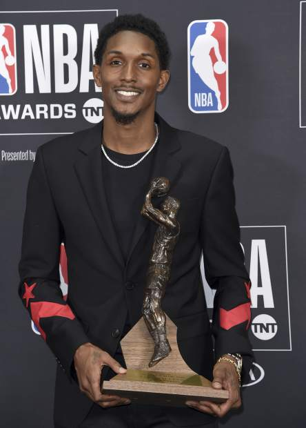 Lou Williams, of the Los Angeles Clippers, poses in the press room with the 6th Man award at the NBA Awards on Monday, June 25, 2018, at the Barker Hangar in Santa Monica, Calif. (Photo by Richard Shotwell/Invision/AP)
