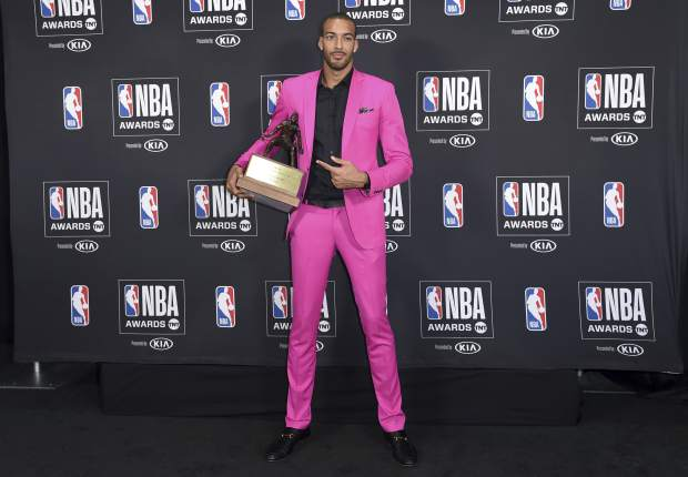 Rudy Gobert, of the Utah Jazz, poses in the press room with the defensive player of the year award at the NBA Awards on Monday, June 25, 2018, at the Barker Hangar in Santa Monica, Calif. (Photo by Richard Shotwell/Invision/AP)