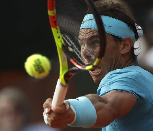 Spain's Rafael Nadal plays a shot against Austria's Dominic Thiem in the men's final match of the French Open tennis tournament at the Roland Garros stadium in Paris, France, Sunday, June 10, 2018. (AP Photo/Alessandra Tarantino)