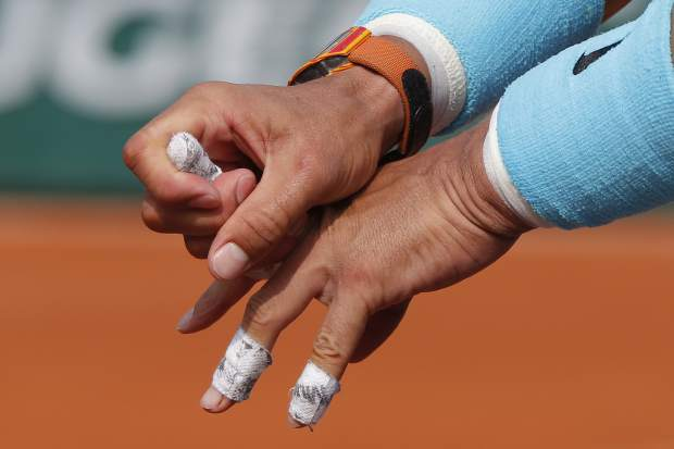 Spain's Rafael Nadal bend his finger in the men's final match of the French Open tennis tournament against Austria's Dominic Thiem at the Roland Garros stadium in Paris, France, Sunday, June 10, 2018. (AP Photo/Michel Euler)