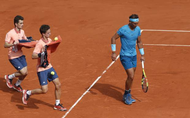 Ball boys run after Spain's Rafael Nadal as he plays Austria's Dominic Thiem during the men's final match of the French Open tennis tournament at the Roland Garros stadium, Sunday, June 10, 2018 in Paris. (AP Photo/Thibault Camus)