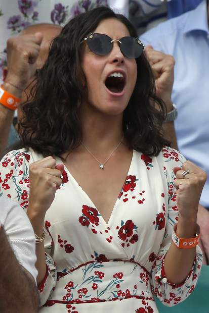 Spain's Rafael Nadal's girlfriend Xisca Perello, center left, screams as he scores a point against Austria's Dominic Thiem in the men's final match of the French Open tennis tournament at the Roland Garros stadium in Paris, France, Sunday, June 10, 2018. (AP Photo/Michel Euler)