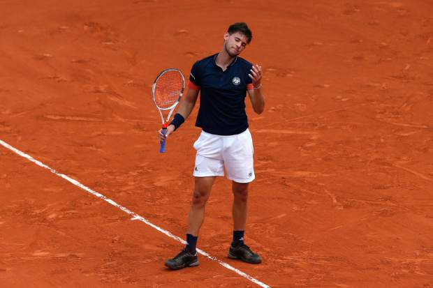 Austria's Dominic Thiem reacts as he plays Spain's Rafael Nadal during the men's final match of the French Open tennis tournament at the Roland Garros stadium, Sunday, June 10, 2018 in Paris. (AP Photo/Thibault Camus)