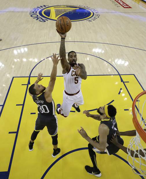 Cleveland Cavaliers guard J.R. Smith (5) shoots against Golden State Warriors guard Stephen Curry (30) and center JaVale McGee during the first half of Game 2 of basketball's NBA Finals in Oakland, Calif., Sunday, June 3, 2018. (AP Photo/Marcio Jose Sanchez, Pool)