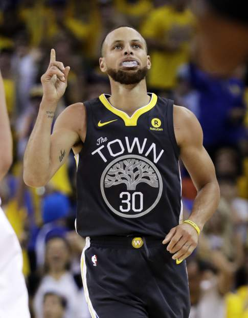 Golden State Warriors guard Stephen Curry (30) gestures after scoring against the Cleveland Cavaliers during the first half of Game 2 of basketball's NBA Finals in Oakland, Calif., Sunday, June 3, 2018. (AP Photo/Marcio Jose Sanchez)