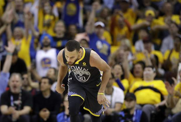 Golden State Warriors guard Stephen Curry (30) reacts after scoring against the Cleveland Cavaliers during the second half of Game 2 of basketball's NBA Finals in Oakland, Calif., Sunday, June 3, 2018. (AP Photo/Marcio Jose Sanchez)