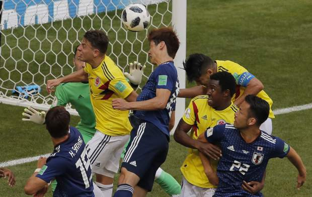 Japan's Yuya Osako, center, scores his. Sides 2nd goal during the group H match between Colombia and Japan at the 2018 soccer World Cup in the Mordavia Arena in Saransk, Russia, Tuesday, June 19, 2018. (AP Photo/Vadim Ghirda)