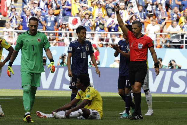 referee Damir Skomina from Slovenia whistles a penalty for Japan during the group H match between Colombia and Japan at the 2018 soccer World Cup in the Mordavia Arena in Saransk, Russia, Tuesday, June 19, 2018. (AP Photo/Eugene Hoshiko)