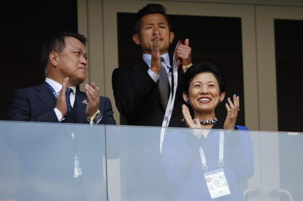 Japan's Princess Takamado, right, applauds prior to the group H match between Colombia and Japan at the 2018 soccer World Cup in the Mordavia Arena in Saransk, Russia, Tuesday, June 19, 2018. (AP Photo/Eugene Hoshiko)