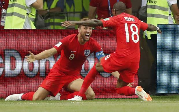 England's Harry Kane, left, celebrates his winning goal with England's Ashley Young during the group G match between Tunisia and England at the 2018 soccer World Cup in the Volgograd Arena in Volgograd, Russia, Monday, June 18, 2018. (AP Photo/Frank Augstein)
