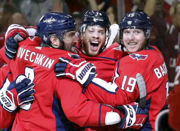 Washington Capitals defenseman John Carlson, center, celebrates his goal against the Vegas Golden Knights with Alex Ovechkin, left, of Russia, and Nicklas Backstrom, right, of Sweden, during the second period in Game 4 of the NHL hockey Stanley Cup Final, Monday, June 4, 2018, in Washington. (AP Photo/Alex Brandon)
