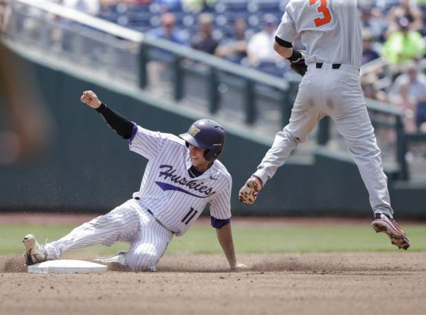 Washington's AJ Graffanino (11) steals second base against Oregon State second baseman Nick Madrigal (3) in the second inning of an NCAA College World Series baseball elimination game in Omaha, Neb., Monday, June 18, 2018. (AP Photo/Nati Harnik)