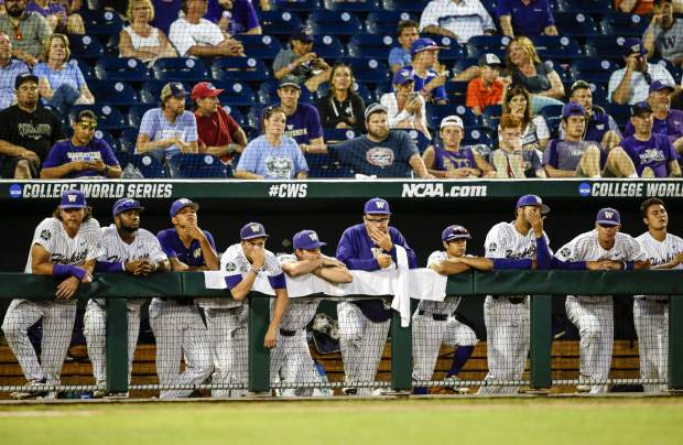 Washington players watch from the dugout during the eighth inning after Oregon State's Jack Anderson hit a two-run double against Washington, in an NCAA College World Series baseball elimination game in Omaha, Neb., Monday, June 18, 2018. Oregon State won 14-5. (AP Photo/Nati Harnik)
