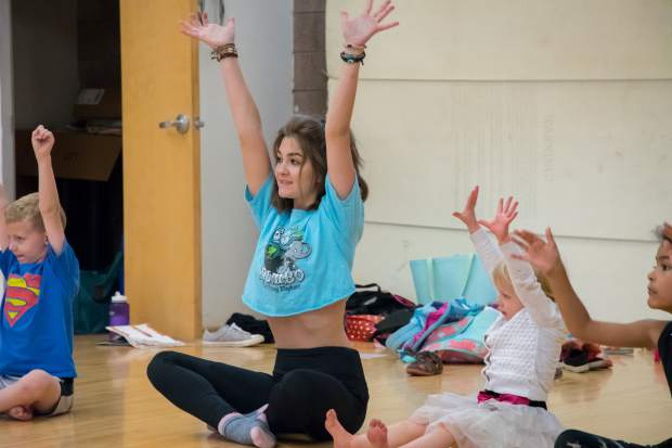 Glenwood Springs High School sophomore Skylar McLaren interacts with kids as a dance intern instructor.
